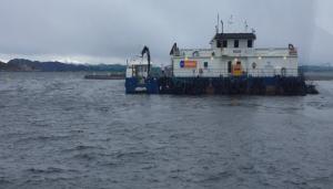 Die Feedstation Leroy in Norwegen - Boot auf dem Meer, vieles ist mechanisiert.